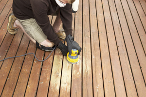 Exterior Carpentry- repairing wood rot in deck by sanding & staining